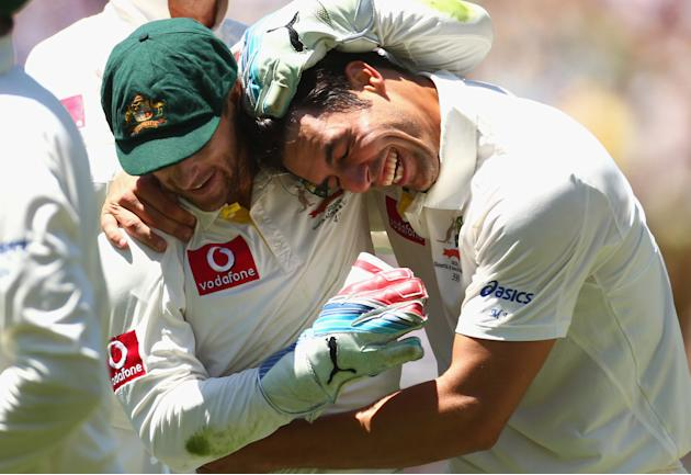 Matthew Wade and Mitchell Johnson of Australia celebrates after they dismissed Kumar Sangakkara of Sri Lanka during day one of the Second Test match between Australia and Sri Lanka at Melbourne Cricke