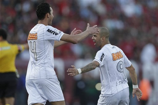 Diego Tardelli, right, of Brazil's Atletico Mineiro is congratulated by teammate Rever Humberto after scoring against Mexico's Club Tijuana Xoloitzcuintles during the second half of their Copa Liberta
