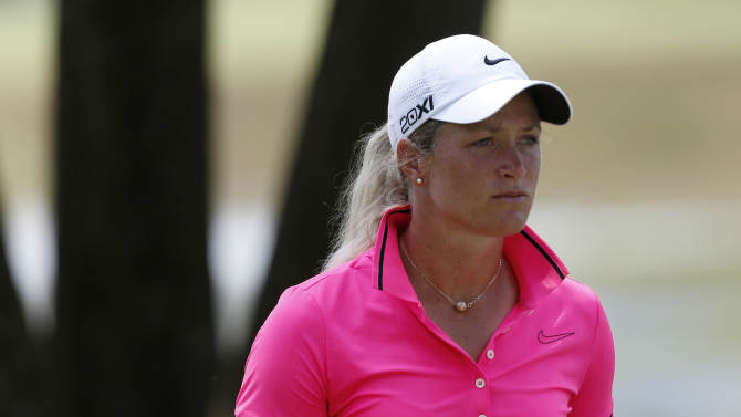 Suzann Pettersen walks to the first tee during the second round of the U.S. Women's Open golf tournament, Friday, July 6, 2012, in Kohler, Wis. (AP Photo/Jeffrey Phelps)