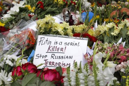 File photo of flowers and a message left for victims of Malaysia Airlines Flight MH17 outside the Dutch embassy in Kiev