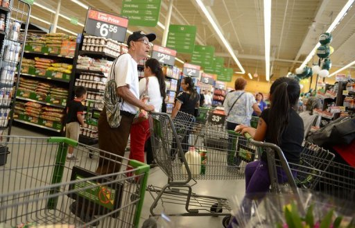 &lt;p&gt;Shoppers wait in line to pay for their purchases during the grand pening of a new Walmart in California in September. The US economy grew at an annual rate of 2.0 percent in the third quarter from the second quarter, the government said in its first estimate for the July-September period.&lt;/p&gt;