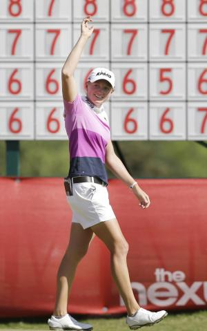 Stacy Lewis waves after winning the North Texas LPGA Shootout golf tournament at Las Colinas Country Club in Irving, Texas, Sunday, May 4, 2014. (AP Photo/LM Otero)