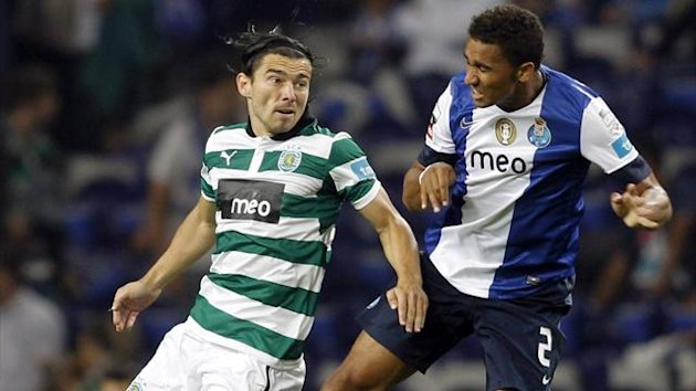 Porto's Danilo da Silva (R) jumps for the ball with Sporting Lisboa's Danijel Pranjic (Reuters)