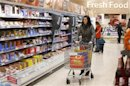 Customers shop at a Tesco store in Bishop's Stortford, southern England