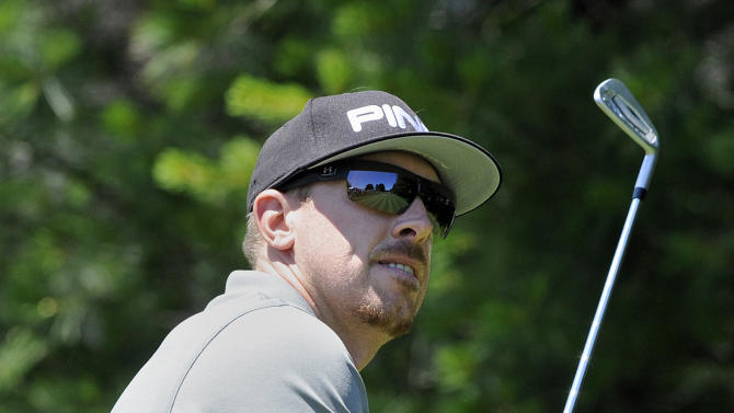 Hunter Mahan watches his tee shot on the eighth hole during the first round of the Travelers Championship golf tournament in Cromwell, Conn., Thursday, June 20, 2013.  (AP Photo/Fred Beckham)