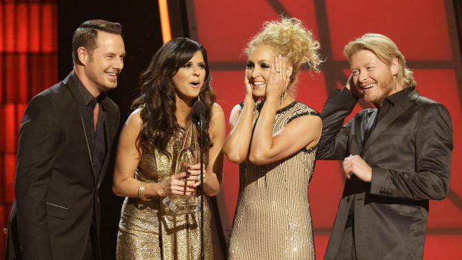 """Musical group Little Big Town, from left, Jimi Westbrook, Karen Fairchild, Kimberly Schlapman and Phillip Sweet, accept the award for single of the year for """"Pontoon"""" at the 46th Annual Country Music Awards at the Bridgestone Arena on Thursday, Nov. 1, 2012, in Nashville, Tenn. (Photo by Wayde Payne/Invision/AP)"""