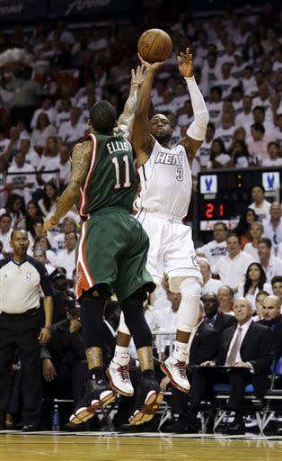 James has 27, Heat top Bucks 110-87 in Game 1