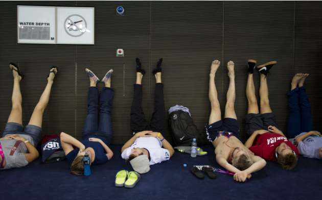 Paralympics athletes from the United States rest after their training at the swimming pool of the Aquatic Center ahead of the 2012 Paralympics Olympics, London, Tuesday, Aug. 28, 2012. The opening cer