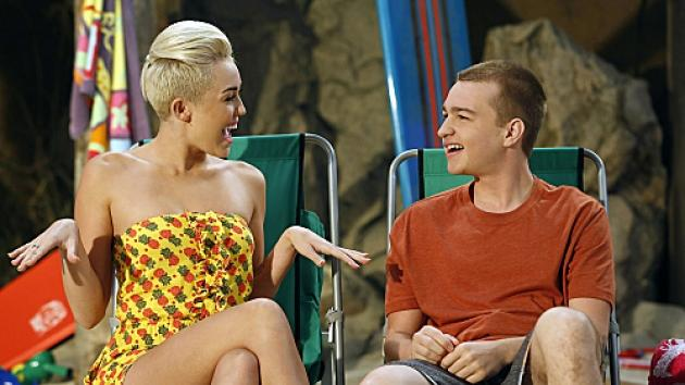 Miley Cyrus as Missi and Angus T. Jones as Jake in 'Two and a Half Men,' Oct. 2012 -- CBS