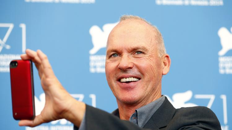 "U.S. actor Michael Keaton poses during the photo call for the movie ""Birdman or (The unexpected virtue of ignorance)"" at the 71st Venice Film Festival"
