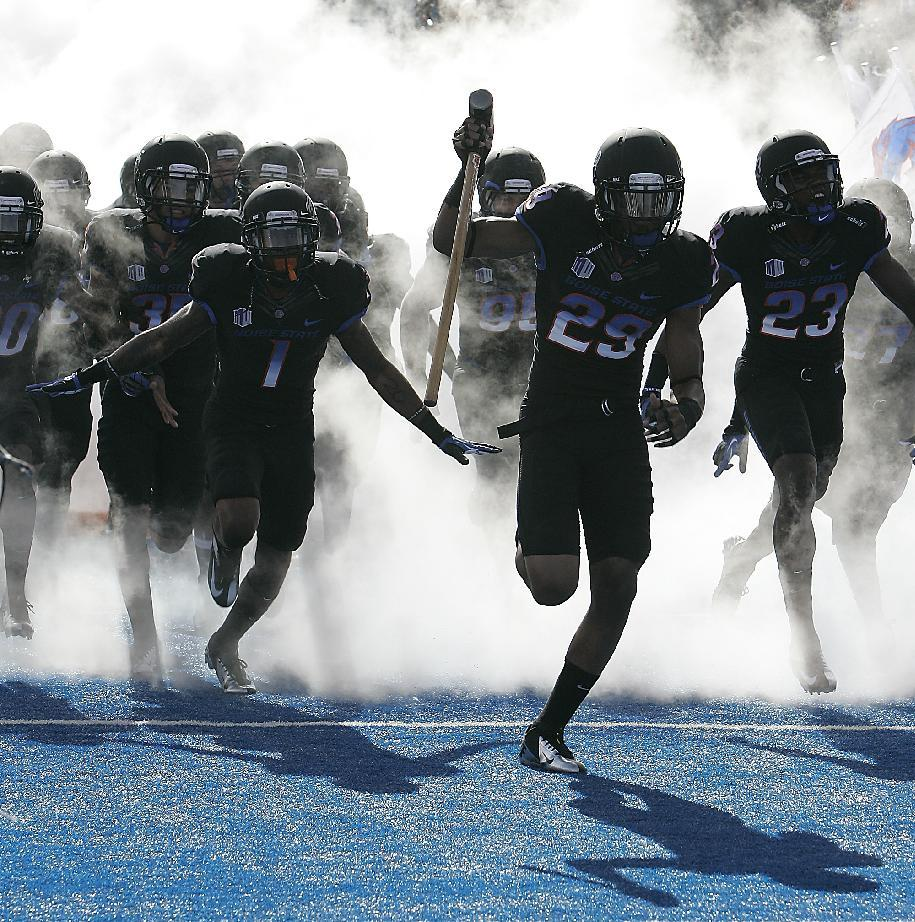 Boise State's Lee Hightower (29) is the first to take the field as Boise State wears black uniforms for an NCAA college football game against UNLV on Saturday, Oct. 20, 2012 in Boise, Idaho. Boise State won 32-7. (AP Photo/Matt Cilley)