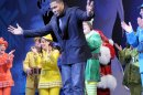 """This image released by ABC shows former NFL player Michael Strahan, center, bowing during a curtain call for the matinee show of the musical """"Elf,"""" Wednesday, Dec. 5, 2012 in New York. Strahan, a co-host on the morning show """"Live! with Kelly and Michael,"""" made his Broadway debut Wednesday playing three roles in the Christmas-themed musical. (AP Photo/Disney-ABC, Lorenzo Bevilaqua)"""