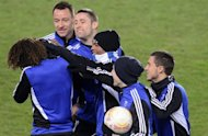 Chelsea players enjoy a joke during training on February 13, 2013, on the eve of their Europa League match at Sparta Prague. Traditional European heavyweights Chelsea and Liverpool headline a quartet of English clubs harbouring Europa League dreams as the round of 32 gets under way on Thursday