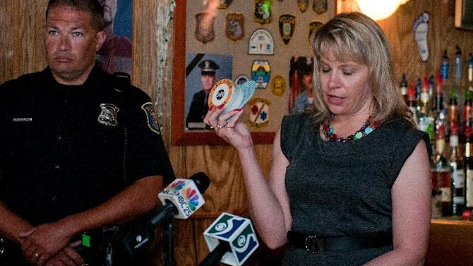 Lynn Sutfin, Office of Highway Safety Planning spokeswoman, talks about a talking urinal cake during a news conference at Green Hut, 1301 Columbus Ave. in Bay City, Mich., July 2, 2012. Michigan hopes to keep drunks off the road with the help from a special message in men's bathrooms featuring an attention-getting woman's voice. (AP Photo/The Bay City Times, Yfat Yossifor)