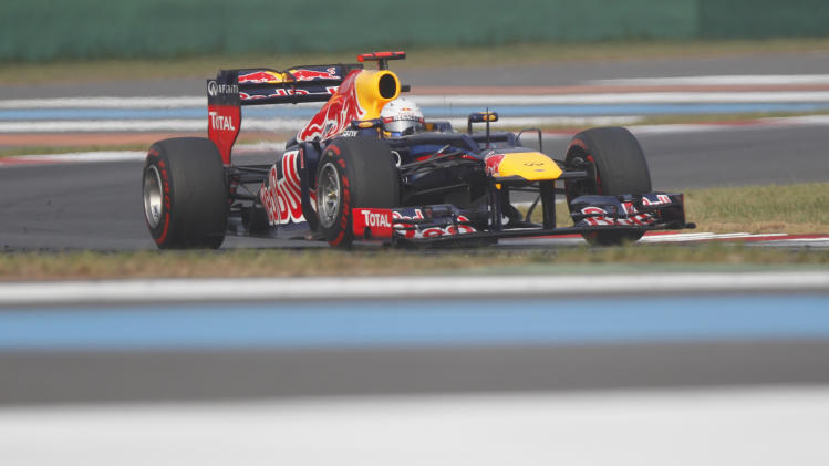 Red Bull driver Sebastian Vettel of Germany steers his car during the Korean Formula One Grand Prix at the Korean International Circuit in Yeongam, South Korea, Sunday, Oct. 14, 2012. (AP Photo/Dita Alangkara)
