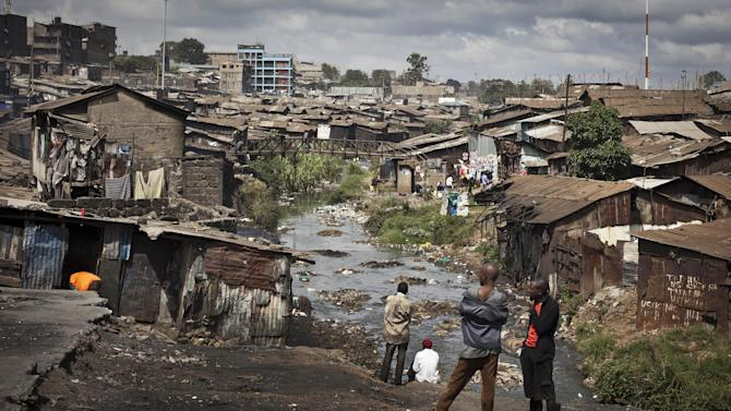 This photo taken Tuesday, Feb. 26, 2013 shows a view of the Mathare slum of Nairobi, Kenya. Kenya on Monday holds its first presidential election since its 2007 vote devolved into months of tribal violence, and in recent weeks in Nairobi's most dangerous slum Mathare dozens of tin shack homes have been burned to the ground and some families are moving into zones controlled by their own clans. (AP Photo/Ben Curtis)