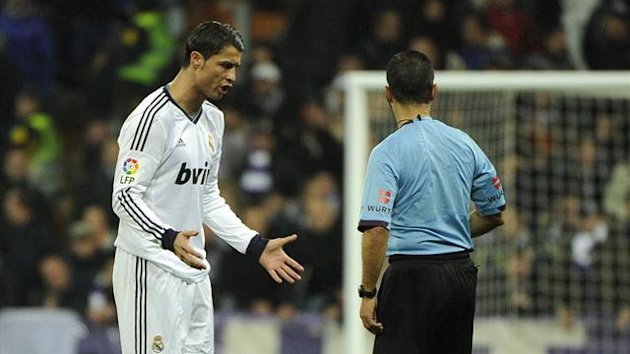 AFP: Real Madrid&#39;s Portuguese forward Cristiano Ronaldo (L) speak with referee Jose Luis Paradas Romero (R) during the Spanish league football match Real Madrid vs Rayo Vallecano at the Santiago Bernabeu stadium in Madrid on Feb 17