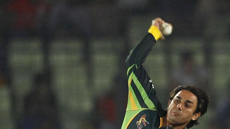 Pakistani cricket player Saeed Ajmal bowls during the Asia Cup final cricket match between Sri Lanka and Pakistan in Dhaka, Bangladesh, Saturday, March 8, 2014. (AP Photo/A.M. Ahad)