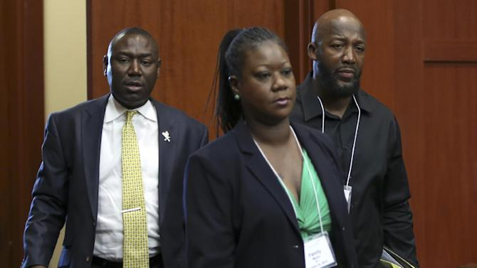 Tracy Martin, right, and Sybrina Fulton, center, parents of Trayvon Martin, arrive with their attorney Benjamin Crump for the George Zimmerman trial in Seminole circuit court in Sanford, Fla., Thursday, June 20, 2013. Zimmerman has been charged with second-degree murder for the 2012 shooting death of Trayvon Martin.(AP Photo/Orlando Sentinel, Gary Green, Pool)