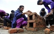 Students attend a construction class at Kathmandu&#39;s Jiri Technical Institute, where some 80 former Maoist fighters are being taught to design the roads, buildings and canals which will form the future of a state they fought against for a decade