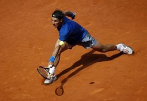 Nadal of Spain returns the ball to Nieminen of Finland during their match at the Madrid Open tennis tournament