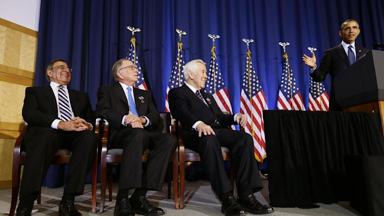 President Barack Obama talks about his travels with Sen. Dick Lugar, R-Ind., second right, as he speaks at  the Nunn-Lugar Cooperative Threat Reduction (CTR) symposium being held at the National Defense University at Fort McNair in Washington, Monday, Dec. 3, 2012. Pictured far left is Secretary of Defense Leon Panetta, and former Sen. Sam Nunn, D-Ga., second left. (AP Photo/Charles Dharapak)
