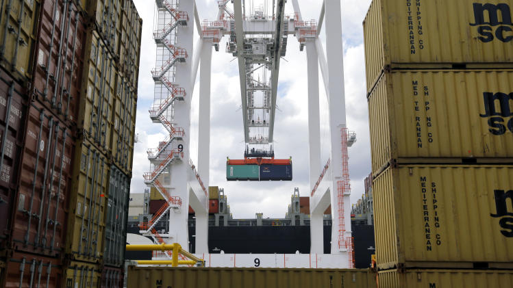 In this March 1, 2013 photo, a crane removes a container from a ship at the Port of Baltimore's Seagirt Marine Terminal in Baltimore. The government reports on the U.S. trade deficit for March, Thursday, May 2, 2013. (AP Photo/Patrick Semansky)