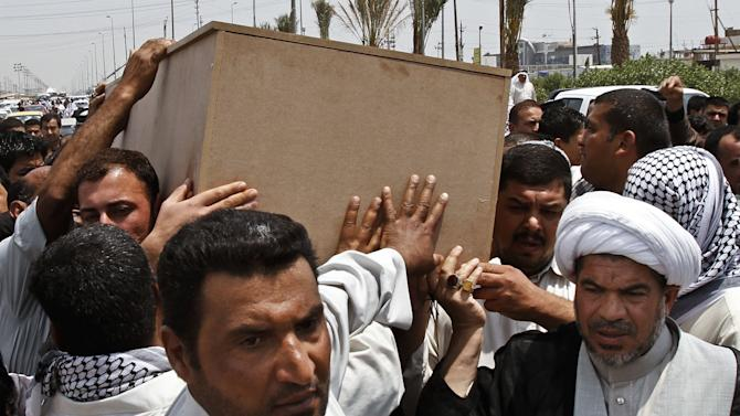 Family members of Diaa Mutashar al-Issawi carry his coffin during his funeral in Basra, Iraq's second-largest city, 340 miles (550 kilometers) southeast of Baghdad, Iraq, Monday, May 6, 2013. The Iraqi Shiite fighter's body was collected Monday morning at a border crossing with Iran, then carried through the streets of this southern Iraqi city as mourners vowed a similar sacrifice to protect a revered shrine in Syria. (AP Photo/ Nabil Al-Jurani)