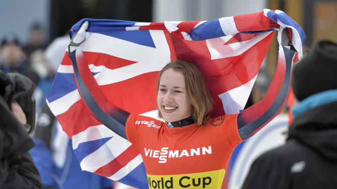 Elizabeth Yarnold of Great Britain celebrates with the flag after winning the women's Skeleton World Cup in Winterberg, Germany, on Saturday, Jan. 4, 2014. (AP Photo/Martin Meissner)