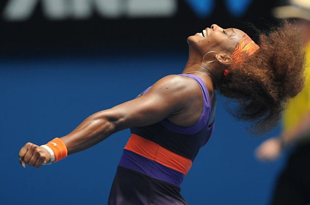 Serena Williams of the US celebrates after defeating Spain's Garbine Muguruza in their second round match at the Australian Open tennis championship in Melbourne, Australia, Thursday, Jan. 17, 2013. (