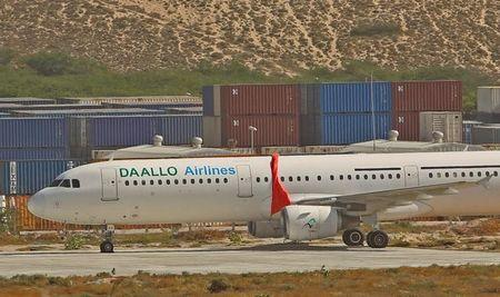 An aircraft belonging to Daallo Airlines is parked at the Aden Abdulle international airport after making an emergency landing following an explosion inside the plane in Somalia's capital Mogadishu,