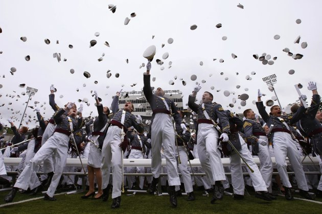 Graduating cadets toss their caps into the air at the conclusion of their graduation ceremony at the United States Military Academy at West Point, New York