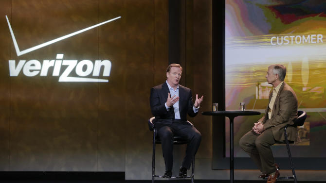 FILE - In this Jan. 8, 2013, file photo, NFL football commissioner Roger Goodell, left, and Verizon CEO Lowell McAdam talk about Verizon mobile products that allow NFL fans to watch games and interact with each other at the Consumer Electronics Show, in Las Vegas.  Verizon strengthened its position at the top of the U.S. wireless industry in its latest quarter by raking in new subscribers and selling tons of iPhones, but also posted a record loss. Verizon's loss for the October to December period compared with a loss of $2.02 billion or 71 cents per share, a year ago. (AP Photo/Julie Jacobson)