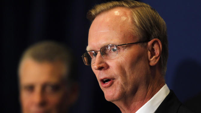 New York Giants owner John Mara speaks at a news conference where it was  announced that NFL owners have agreed to a tentative agreement that would end the lockout pending the players approval in College Park, Ga., on Thursday, July 21, 2011. Pittsburgh Steelers owner Dan Rooney, background, looks on. (AP Photo/John Bazemore)