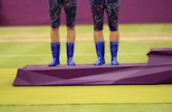 The blue boots of Czech Republic's Andrea Hlavackova (left) and Lucie Hradecka as they stand on the podium after receiving their silver medals for the Olympics tennis women's doubles. Experts say fashions at the Olympics have shown as much bad taste as elegance