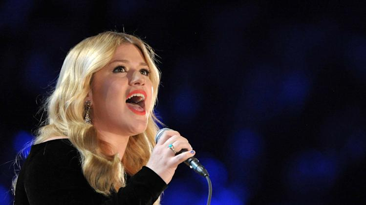 "FILE - In this Sunday, Feb. 10, 2013 file photo, Kelly Clarkson performs on stage at the 55th annual Grammy Awards in Los Angeles. The British government has stepped in to stop singer Kelly Clarkson from taking a ring once owned by author Jane Austen out of the country. The ""American Idol"" winner bought the gold and turquoise ring at auction last year for just over 150,000 pounds ($228,000). But on Thursday, Aug. 1, 2013, Culture Minister Ed Vaizey put an export bar on the item until Sept. 30 in the hope that a British buyer will come forward. (Photo by John Shearer/Invision/AP, File)"