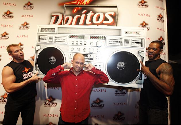 COMMERCIAL IMAGE - In this photograph taken by AP Images for Doritos, Mike Judge arrives at the Doritos JACKED Maxim Party in Austin, Texas, Thursday, March 15, 2012. The 56-foot-tall vending machine