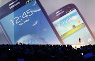 This file photo, released by Samsung Electronics, shows a display of the company&#39;s latest smartphone, the Galaxy S3, during a launch event in London in May. Samsung, world&#39;s largest smartphone maker, said on Monday it expects to have sold 10 million of its Galaxy S3 model by the end of July, two months after its launch