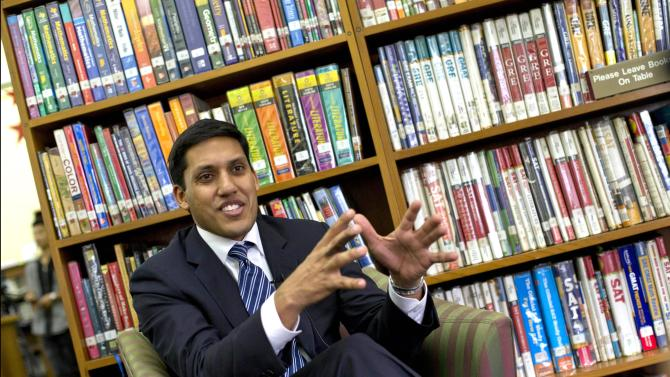 USAID head Rajiv Shah gestures during an interview with The Associated Press in Yangon, Myanmar, Thursday, March 7, 2013. Cisco Systems plans to establish two network training centers in Myanmar, as global technology companies begin to move into one of the least-connected places on Earth. The announcement Thursday came on the heels of a USAID-sponsored delegation of executives from Cisco, Google, HP, Intel and Microsoft to the fast-opening country. (AP Photo/Gemunu Amarasinghe)