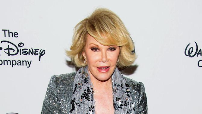 "FILE - In this May 14, 2014 file photo, TV personality Joan Rivers attends A Celebration of Barbara Walters in New York. Jerry Seinfeld says that Joan Rivers was to join him for an episode of his digital series ""Comedians in Cars Getting Coffee,"" until he got a call saying she had to postpone because she was undergoing a medical procedure. Rivers went into cardiac arrest following a throat procedure on Aug. 28 and died on Sept. 4. (Photo by Charles Sykes/Invision/AP, File)"