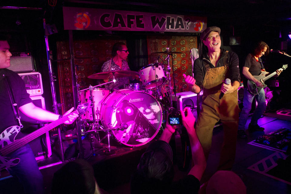 Van Halen members Wolfgang Van Halen, left, Alex Van Halen, David Lee Roth and Eddie Van Halen perform at Cafe Wha? in New York, Thursday, Jan. 5, 2012. (AP Photo/Charles Sykes)