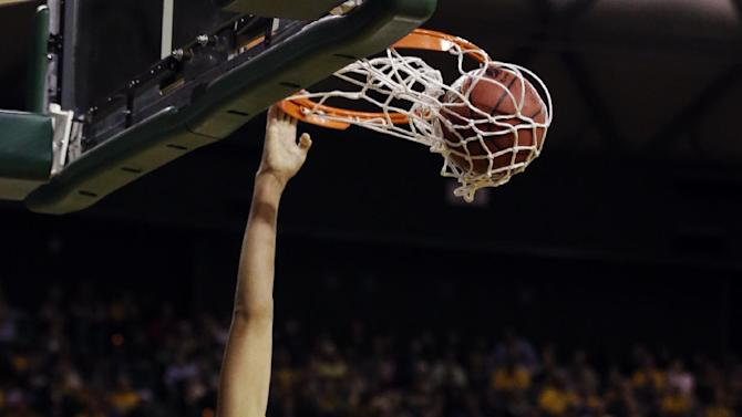 Baylor's Brittney Griner (42) dunks over Florida State's Natasha Howard (33) in the second half of a second-round game in the women's NCAA college basketball tournament Tuesday, March 26, 2013, in Waco, Texas. Baylor won 85-47. (AP Photo/Tony Gutierrez)
