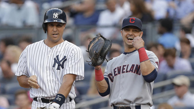 New York Yankees' Mark Teixeira, left, chats with Cleveland Indians first baseman Nick Swisher during a baseball game at Yankee Stadium in New York, Monday, June 3, 2013. It was the first time Swisher was back at Yankee Stadiium since he played for the Yankees. (AP Photo/Kathy Willens)