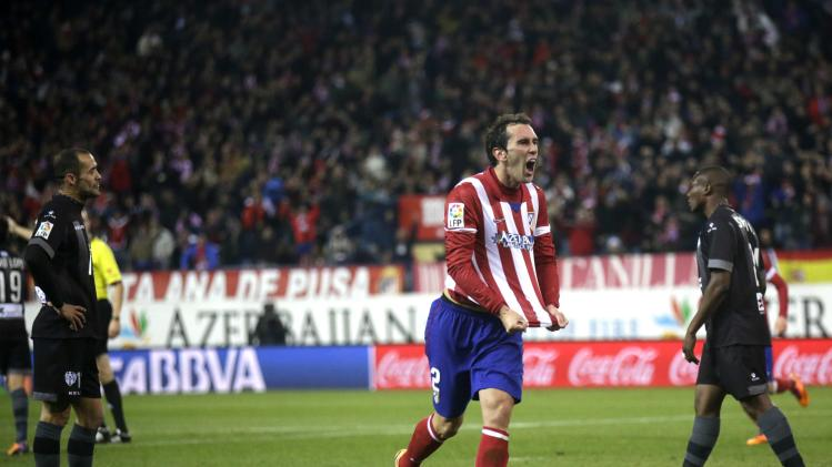 Atletico Madrid's Diego Godin celebrates his goal against Levante during their Spanish first division soccer match in Madrid