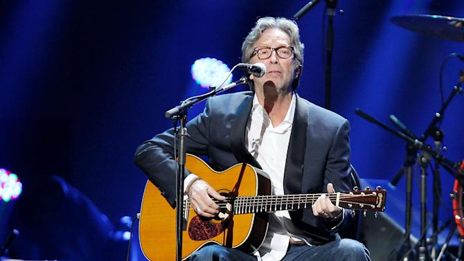 This image released by Starpix shows Eric Clapton performing at the 12-12-12 The Concert for Sandy Relief at Madison Square Garden in New York on Wednesday, Dec. 12, 2012. Proceeds from the show will be distributed through the Robin Hood Foundation. (AP Photo/Starpix, Dave Allocca)