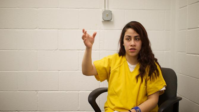 In this March 21, 2014 photo, Cinthya Garcia-Cisneros, 19, speaks in a room at the Northwest Detention Center in Tacoma, Wash. An immigration judge has dismissed the case against Garcia-Cisneros, who faced possible deportation to Mexico after she drove an SUV into a leaf pile, accidentally killing two young girls playing in it. U.S. Immigration and Customs Enforcement on Tuesday, Aug. 19, 2014 said that Garcia-Cisneros was released on Aug. 14. (AP Photo/The Oregonian, Benjamin Brink) MAGS OUT; TV OUT; LOCAL TELEVISION OUT; LOCAL INTERNET OUT; THE MERCURY OUT; WILLAMETTE WEEK OUT; PAMPLIN MEDIA GROUP OUT