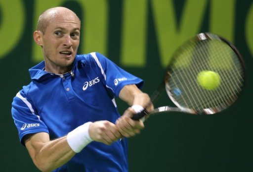Russia&#39;s Nikolay Davydenko returns the ball to Victor Hanescu of Romania during the first day of the 2013 ATP Qatar Open in Doha on December 31, 2012. Davydenko, one of only a handful of players to have beaten Rafael Nadal and Roger Federer in the same tournament, has a new year&#39;s resolution of making a last bid to return the world&#39;s top 20 before retirement