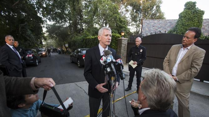 Los Angeles Police Captain William P. Hayes speaks to the media outside a home in the Hollywood Hills area of Los Angeles, Tuesday, March 31, 2015. Police say a man was found dead at the home of Andrew Getty, heir to Getty oil fortune. (AP Photo/Ringo H.W. Chiu)