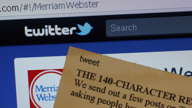 "This Wednesday, Aug. 24, 2011 photo displays an index card with the entry ""tweet"" next to a computer screen showing the Twitter website,  at the Merriam-Webster headquarters in Springfield, Mass.  Used as both a noun and a verb, the word describing a post made on the online Twitter message service is among more than 100 new terms revealed Thursday for the dictionary publisher's newest edition.  (AP Photo/Charles Krupa)"