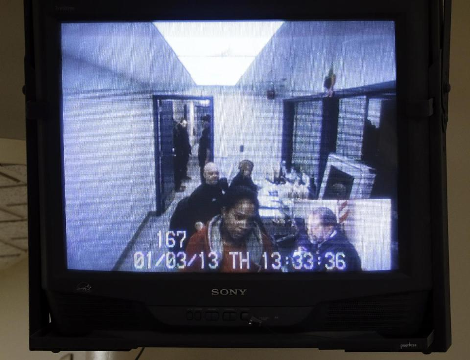 Semeria Greene is arraigned via video link in Detroit, Thursday, Jan. 3, 2013. A not-guilty plea has been entered for Greene, who is charged with fatally stabbing her daughter three days before the girl's ninth birthday.   (AP Photo/Carlos Osorio)
